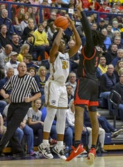 Alex Williams of Moeller attempts a 3-pointer against La Salle at Moeller High School, Friday, Jan. 31, 2020