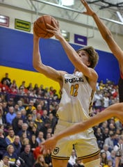 Will McCracken of Moeller shoots the ball against La Salle at Moeller High School, Friday, Jan. 31, 2020.
