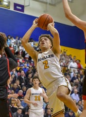 Max Land of Moeller attempts a shot against La Salle at Moeller High School, Friday, Jan. 31, 2020