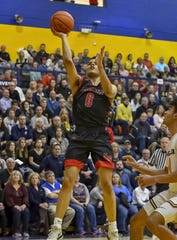 Jeffrey Queen Jr. of La Salle attempts a lay up against Moeller at Moeller High School, Friday, Jan. 31, 2020