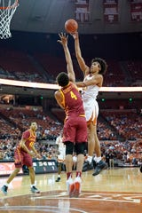 Feb 1, 2020; Austin, Texas, USA;  Texas Longhorns forward Jericho Sims (20) shoots over Iowa State Cyclones forward George Conditt IV (4)  in the first half of the game against the at Frank C. Erwin Jr. Center. Mandatory Credit: Scott Wachter-USA TODAY Sports