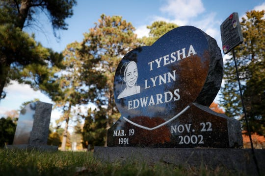 The gravestone of Tyesha Edwards, the victim of a 2002 shooting that resulted in the murder conviction against Myon Burrell, rests at Washburn-McReavy Crystal Lake Funeral Chapel and Cemetery, Thursday, Oct. 24, 2019, in Minneapolis. (AP Photo/John Minchillo)