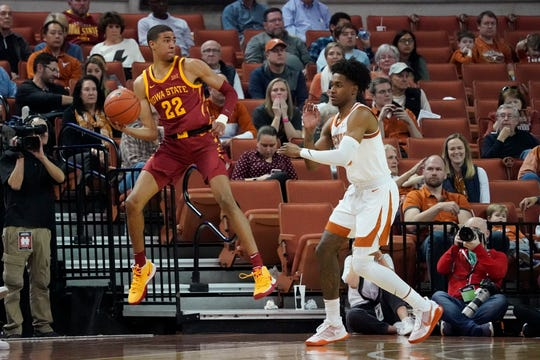 Feb 1, 2020; Austin, Texas, USA; Iowa State Cyclones guard Tyrese Haliburton (22) looks to pass as Texas Longhorns guard Jase Febres (13) defends in the second half of the game against the at Frank C. Erwin Jr. Center. Mandatory Credit: Scott Wachter-USA TODAY Sports