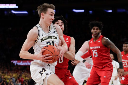 Michigan Franz Wagner drives past Rutgers Geo Baker during the first half Saturday, Feb. 1, 2020, in New York.
