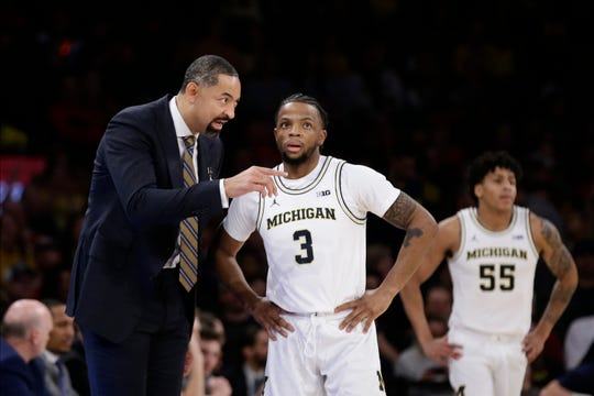Michigan coach Juwan Howard talks to Zavier Simpson during the first half Saturday, Feb. 1, 2020, in New York.