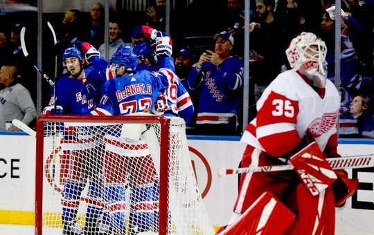 New York Rangers right wing Pavel Buchnevich (89) is congratulated after scoring a goal as Detroit Red Wings goaltender Jimmy Howard skates away during the second period at Madison Square Garden, Jan. 31, 2020.