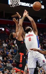 Raptors' Kyle Lowry knocks the ball from Pistons' Andre Drummond for a turnover in the second quarter.