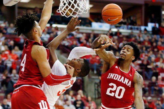 Indiana's De'Ron Davis, right, fouls Ohio State's E.J. Liddell as Trayce Jackson-Davis defends during the second half.