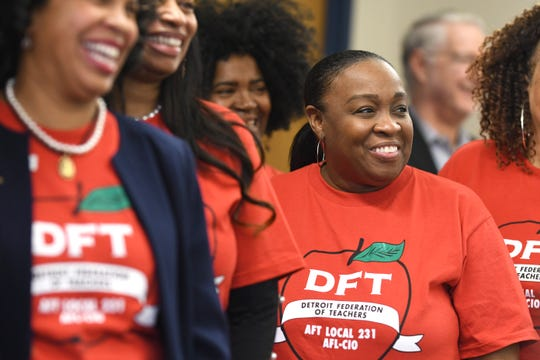 Darnese Wilkinson, center, of the executive board of the Detroit Federation of Teachers,  listens to union officials discuss contract negotiations.