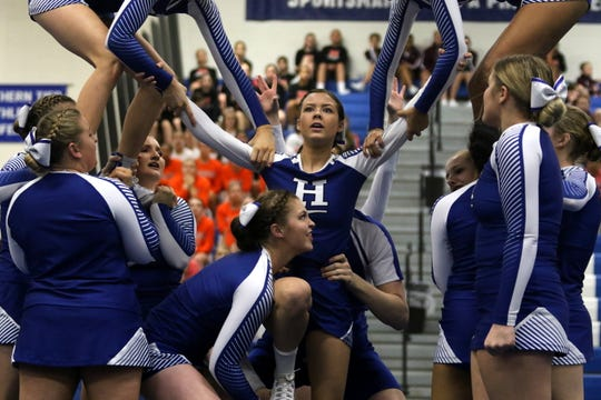Horseheads varsity cheerleaders compete in the coed division at the Southern Tier Athletic Conference Winter Cheerleading Championships on Feb. 1, 2020 at Horseheads Middle School. Horseheads finished first.