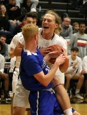 Elmira's Trey Hawken (back) and Horseheads' Carter McCreary battle for the basketball during the Express' 47-37 in boys basketball Jan. 31, 2020 at Elmira High School.