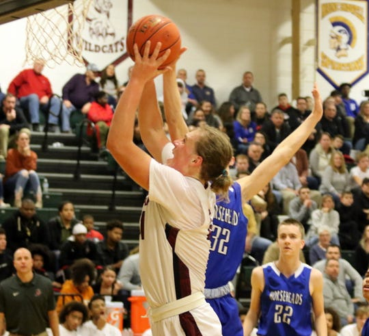 Trey Hawken of Elmira goes up for a shot as Patrick Smith of Horseheads defends during the Express' 47-37 win in boys basketball Jan. 31, 2020 at Elmira High School.