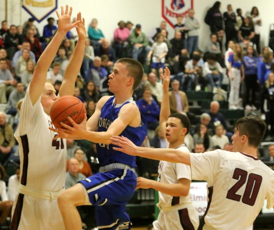 Andrew McLaughlin of Horseheads takes the ball to the basket as Elmira's Trey Hawken (left) and Reilly Houper (20) defend during the Express' 47-37 win in boys basketball Jan. 31, 2020 at Elmira High School.