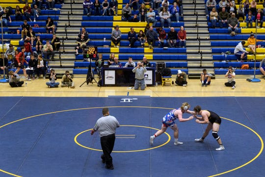 South Spencer's Will Stewart and Boonville's Cordell Heuring go head-to-head during the 220-pound championship match of the IHSAA Sectional tournament held at Castle High School, Saturday afternoon, Feb. 1, 2020. Stewart won the match.