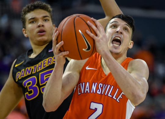 Evansville's Artur Labinowicz (2) drives past Northern Iowa's Noah Carter (35) as the Evansville Purple Aces play the league leading Northern Iowa Panthers at the Evansville Ford Center Saturday afternoon, February 1, 2020.