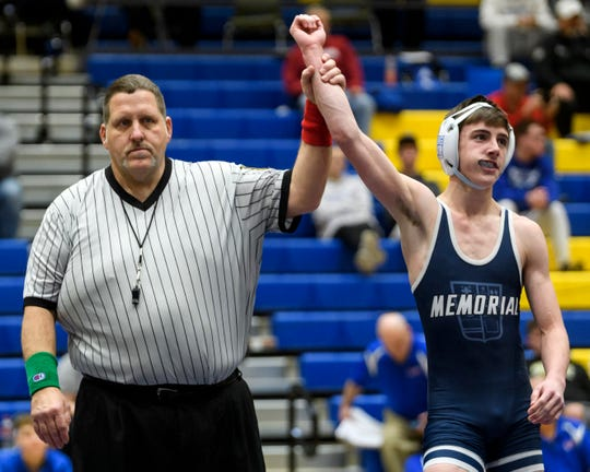 IHSAA Official Ken Halbig, left, of Princeton signals that Memorial's Kyler West has won the 106-pound championship match against Boonville's Gavin Whitsell, not pictured, during the IHSAA Sectional tournament held at Castle High School, Saturday afternoon, Feb. 1, 2020.