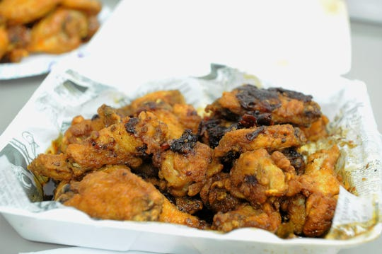 The New Frontier Restaurant and Bar's Jameson wings are liberally coated with the house sauce made with Irish whiskey and chipotle chiles.