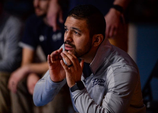 Great Falls High head wrestling coach Luis Carranza watches the action on the mat during Friday's crosstown wrestling meet at Great Falls High.
