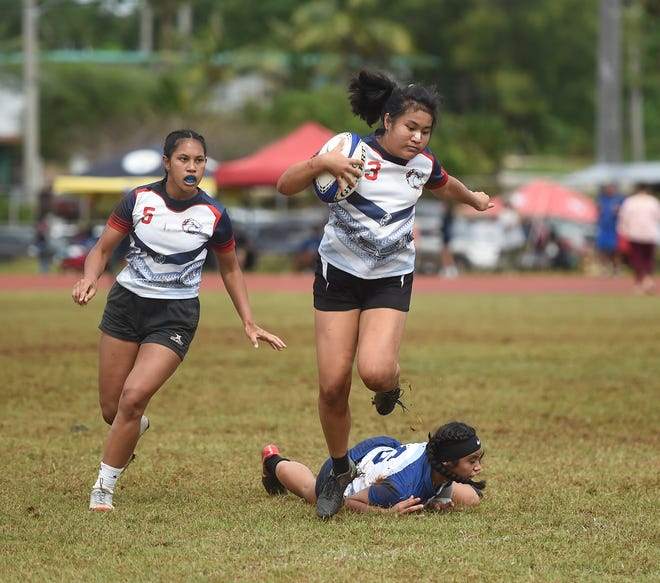 In this file photo from Feb. 1, 2020, Okkodo Bulldogs player Kalei McCormick (3) breaks a tackle during a Guam Rugby Football Union/Interscholastic Sports Association High School Rugby game against the Academy Cougars at the George Washington High School Field in Mangilao. There's still plenty of rugby left before champions are decided on March 14.