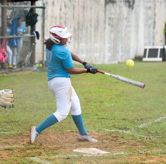 In this file photo from Feb. 1, Southern High's Jeraila Martinez bats against the Simon Sanchez Sharks during their Interscholastic Sports Association Softball League game at Southern High School in Santa Rita. The Dolphins won 15-14.