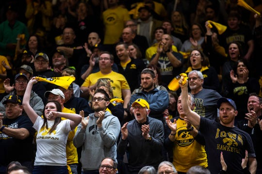 Iowa fans cheer during a NCAA Big Ten Conference wrestling dual, Friday, Jan. 31, 2020, at Carver-Hawkeye Arena in Iowa City, Iowa.