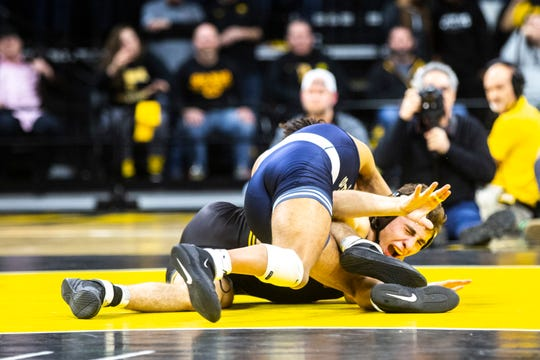 Iowa's Austin DeSanto, right, reacts while wrestling Penn State's Roman Bravo-Young at 133 pounds during a NCAA Big Ten Conference wrestling dual, Friday, Jan. 31, 2020, at Carver-Hawkeye Arena in Iowa City, Iowa.