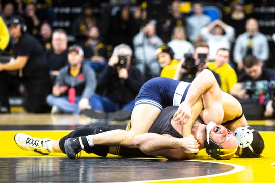 Iowa's Alex Marinelli reacts as blood begins to flow while he wrestles Penn State's Vincenzo Joseph at 165 pounds during a NCAA Big Ten Conference wrestling dual, Friday, Jan. 31, 2020, at Carver-Hawkeye Arena in Iowa City, Iowa.