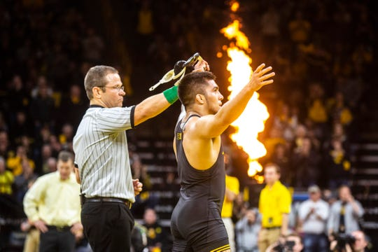 Iowa's Pat Lugo has his hand raised after a match at 149 pounds during a NCAA Big Ten Conference wrestling dual against Penn State, Friday, Jan. 31, 2020, at Carver-Hawkeye Arena in Iowa City, Iowa.