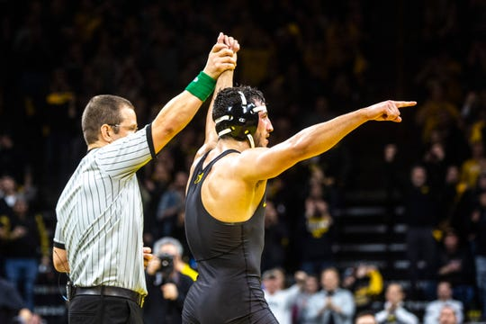 Michael Kemerer has his hand raised after an 11-6 upset of top-ranked Mark Hall.
