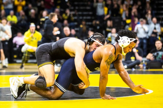Iowa's Michael Kemerer, left, wrestles Penn State's Mark Hall at 174 during a NCAA Big Ten Conference wrestling dual, Friday, Jan. 31, 2020, at Carver-Hawkeye Arena in Iowa City, Iowa.