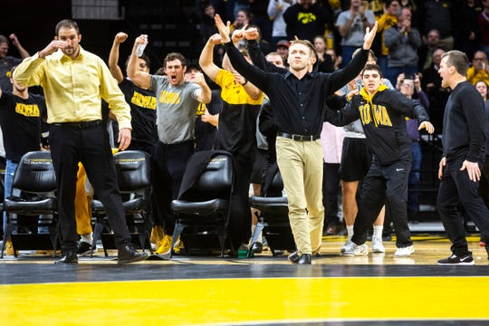 Iowa assistants Bobby Telford and Ryan Morningstar react with wrestlers during a NCAA Big Ten Conference wrestling dual, Friday, Jan. 31, 2020, at Carver-Hawkeye Arena in Iowa City, Iowa.