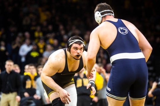 Iowa's Tony Cassioppi, left, wrestles Penn State's Seth Nevills at 285 pounds during a NCAA Big Ten Conference wrestling dual, Friday, Jan. 31, 2020, at Carver-Hawkeye Arena in Iowa City, Iowa.