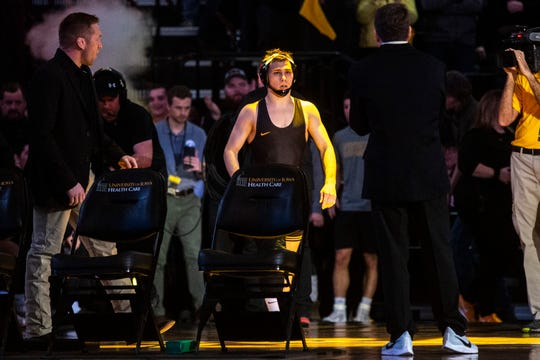 Iowa's Spencer Lee is introduced before his match at 125 pounds during a NCAA Big Ten Conference wrestling dual against Penn State, Friday, Jan. 31, 2020, at Carver-Hawkeye Arena in Iowa City, Iowa.