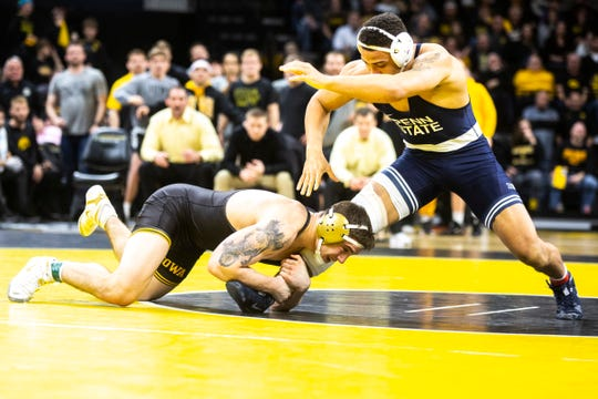 Iowa's Abe Assad, left, attempts a shot on Penn State's Aaron Brooks at 184 pounds during a NCAA Big Ten Conference wrestling dual, Friday, Jan. 31, 2020, at Carver-Hawkeye Arena in Iowa City, Iowa.