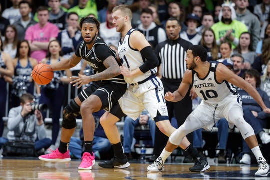 Providence center Nate Watson (0) pushes back against Butler center Derrik Smits (21) in the first half of an NCAA college basketball game in Indianapolis, Saturday, Feb. 1, 2020. (AP Photo/Michael Conroy)