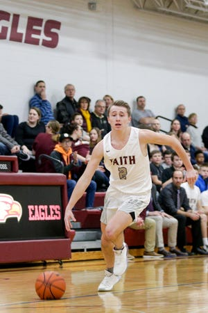 Faith Christian's Avery Norton (2) dribbles during the first quarter of an IHSAA boys basketball game, Friday, Jan. 31, 2020 in Lafayette.