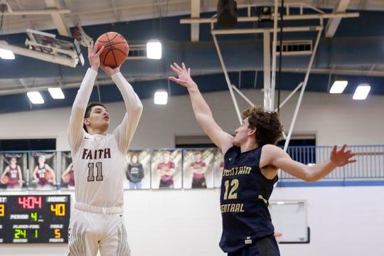 Faith Christian's Matt Miller (11) shoots during the fourth quarter of an IHSAA boys basketball game, Friday, Jan. 31, 2020 in Lafayette.