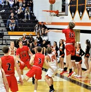 Fairfield Union attempts to block Amanda-Clearcreek's Jayse Miller's shot during the Falcons' 51-37 victory over the Aces Friday night.