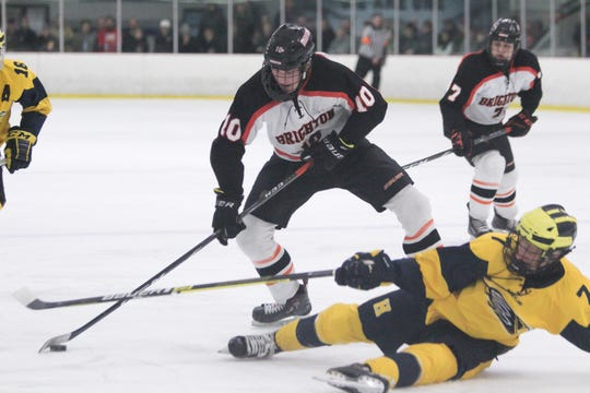 Brighton's Will Jentz tries to get around Hartland's Zane Sheffer during the teams' 3-3 tie on Friday, Jan. 31, 2020.