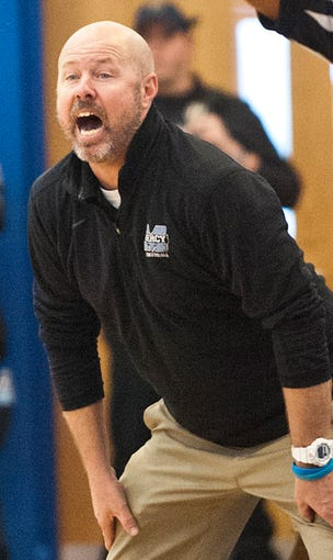 Mercy head basketball coach Keith Baisch yells instructions to his team in the second semifinal game of the Girls Louisville Invitational Tournament at Valley H.S.Feb. 01,  2020