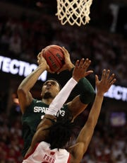 Feb 1, 2020; Madison, Wisconsin, USA; Michigan State Spartans forward Xavier Tillman (23) goes up for a basket as Wisconsin Badgers forward Aleem Ford (2) defends during the firsts half at  the Kohl Center. Mandatory Credit: Mary Langenfeld-USA TODAY Sports