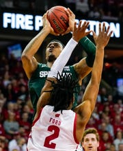 Michigan State's Xavier Tillman (23) shoots over Wisconsin's Aleem Ford (2) during the first half of an NCAA college basketball game Saturday, Feb. 1, 2020, in Madison, Wis. (AP Photo/Andy Manis)