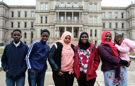 This Sudanese family has started a nonprofit to help people in Sudan.  From left. Djarou Aboubakar, 14, Djaralnabi Aboubakar, 13, Najwa Adam, mother, Chiffa Hassan, 17, Siham Hassan, 19, and Tysir Adam, 3, pose for a photo in front of the Capitol Saturday, Feb. 1, 2020.