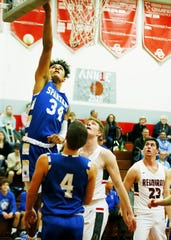 St. Peter's High School Jonah Ramey (34) jumps for the rebound at Loudonville High School Friday, January 31, 2020.