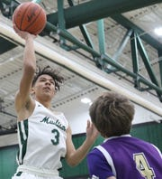 Madison's Isaac Brooks sends a shot off the glass during the Rams' loss to Lexington on Friday night.