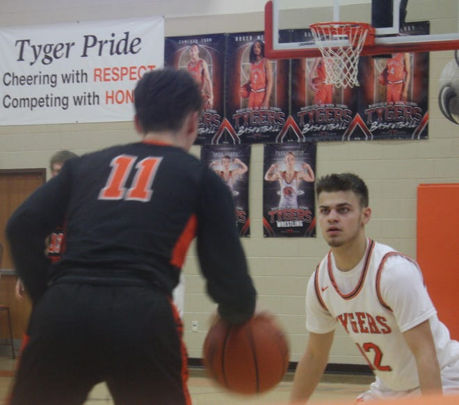 Shad Creamer's face shows the defensive intensity exhibited by his Mansfield Senior Tygers down the stretch as they rallied for a 50-40 victory over Mount Vernon.