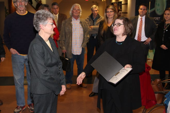 Marion County Family Court Judge Deborah Alspach, left, smiles as she accepts a proclamation from Stephanie Nelson, director of court services for the Supreme Court of Ohio. Nelson honored Alspach for her work with the Supreme Court and her career in Marion County. The judge retired from the bench on Friday.