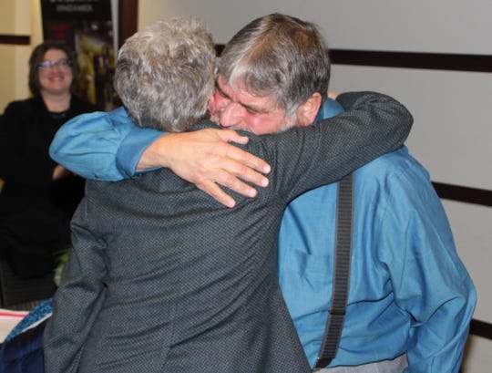 Marion County Family Court Judge Robert Fragale, right, hugs colleague Judge Deborah Alspach during a ceremony celebrating Alspach's career and retirement on Friday at the Marion County Building.