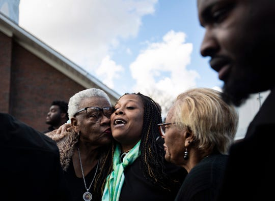 Carla R. Knox is embraced with hugs and kisses from friends and family during the memorial service of her 10-year-old son, Jadon Knox, at New Life Missionary Baptist Church on Saturday.