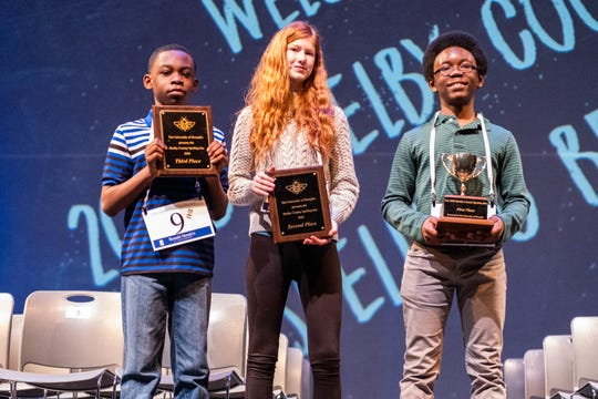 Ronald Hendrix and Isabelle Dibb, who tied for second place, stand next to first place winner William Carter (right) at the conclusion of the 2020 Shelby County Spelling Bee on Saturday.